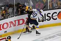 June 12, 2019: St. Louis Blues center Ryan O'Reilly (90) battles Boston Bruins defenseman Brandon Carlo (25) for the puck during game 7 of the NHL Stanley Cup Finals between the St Louis Blues and the Boston Bruins held at TD Garden, in Boston, Mass.  The Saint Louis Blues defeat the Boston Bruins 4-1 in game 7 to win the 2019 Stanley Cup Championship.  Eric Canha/CSM.