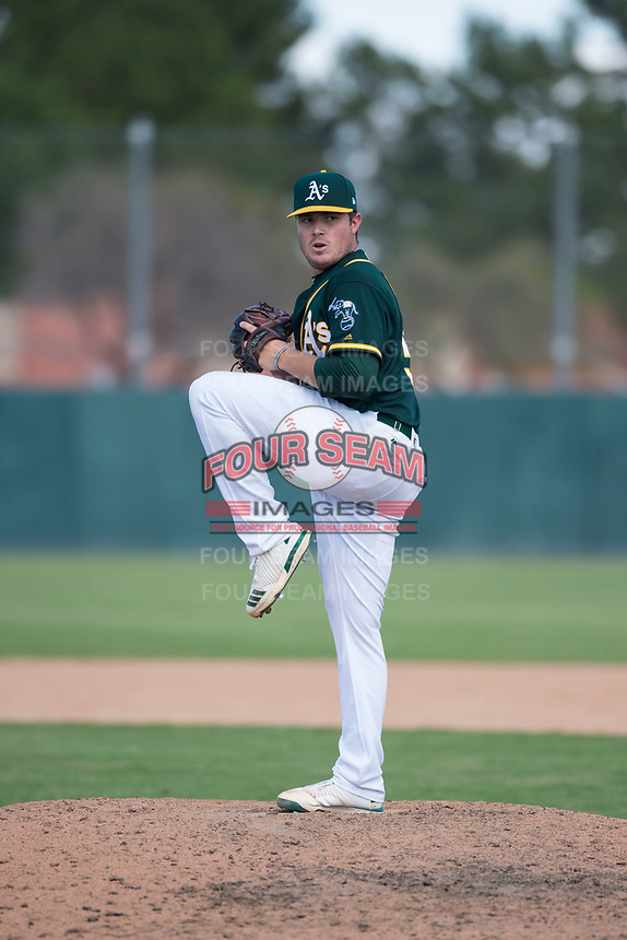 Oakland Athletics relief pitcher Clark Cota (57) delivers a pitch during an Instructional League game against the Chicago White Sox at Lew Wolff Training Complex on October 5, 2018 in Mesa, Arizona. (Zachary Lucy/Four Seam Images)