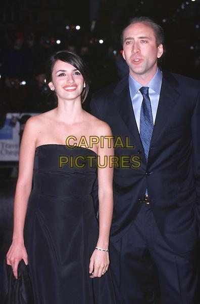 PENELOPE CRUZ & NICHOLAS CAGE .Captain Corelli's Mandolin premiere.Ref: 10807.www.capitalpictures.com.sales@capitalpictures.com.© Capital Pictures .black strapless dress