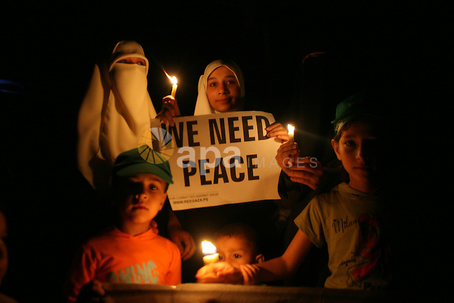 Palestinians take part in a candlelight rally in Gaza City. Gaza plunged into darkness after the only power station stopped due to the lack of industrial diesel, causing about 50 percent shortfall inn electricity in Gaza city.