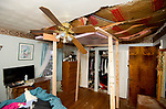 WATERBURY,  CT-012119JS15-  A tree crashed through the roof while owner Olga Guerrera was laying in bed of her Gaylord Drive home in Waterbury late Sunday night. No one was injured but the hope sustained major damage. <br /> Jim Shannon Republican American