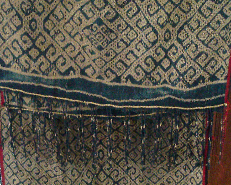 RARE FINE ANTIQUE IKAT FROM INDONESIA WITH RED SELVEDGE & GEOMTRIC CONTINUOUS PATTERN. Has 3-4 stains. A rare piece.