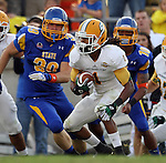 BROOKINGS, SD - SEPTEMBER 14:  Xavier Roberson #1 from Southeastern Louisiana looks for running room past Chad Strehlow #39 and Dom Wright # 10 from South Dakota State University in the second quarter of their game Saturday night at Coughlin Alumni Stadium in Brookings. (Photo by Dave Eggen/Inertia)