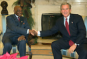 United States President George W. Bush meets President Abdouaye Wade of the Republic of Senegal in the Oval Office at the White House in Washington, D.C. on December 6, 2004.<br /> Credit: Ron Sachs / CNP