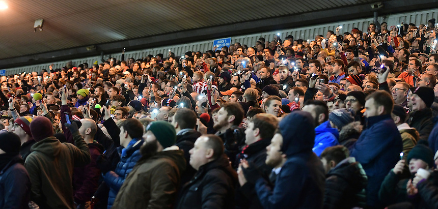 Lincoln City fans during the second half<br /> <br /> Photographer Chris Vaughan/CameraSport<br /> <br /> Emirates FA Cup Third Round Replay - Lincoln City v Ipswich Town - Tuesday 17th January 2017 - Sincil Bank - Lincoln<br />  <br /> World Copyright &copy; 2017 CameraSport. All rights reserved. 43 Linden Ave. Countesthorpe. Leicester. England. LE8 5PG - Tel: +44 (0) 116 277 4147 - admin@camerasport.com - www.camerasport.com