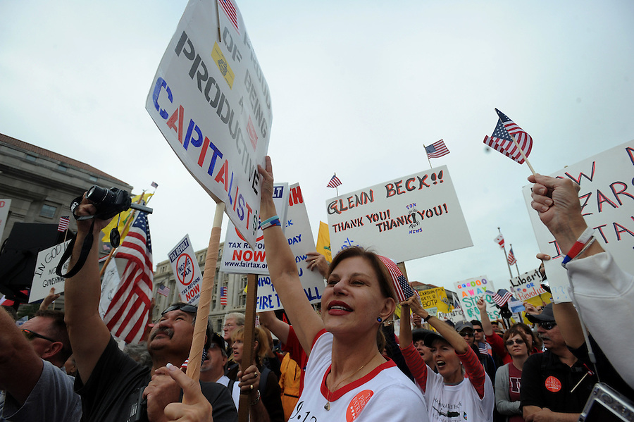 "Janet Gomez, 56, an RN from San Francisco, holds a sign at Freedom Plaza during the Tea Party Protest on Sept. 12, 2009. ""I couldn't get anyone in California to listen to me, I was hoping I would do better here."""