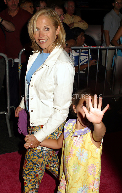 "Opening night for Broadway's newest and hottest show, ""Hairspray"" at Neil Simon Theatre. New York, August 15, 2002. Pictured is KATIE COURIC with her daughter. Please byline: Alecsey Boldeskul/NY Photo Press.   ..*PAY-PER-USE*      ....NY Photo Press:  ..phone (646) 267-6913;   ..e-mail: info@nyphotopress.com"