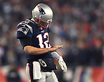 (Foxboro, MA, 01/21/18) New England Patriots quarterback Tom Brady checks his injured right hand during the fourth quarter of the AFC championship NFL football game against the Jacksonville Jaguars at Gillette Stadium on Sunday, January 21, 2018. Photo by Christopher Evans