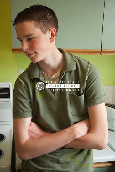 Teenager in hostel kitchen.