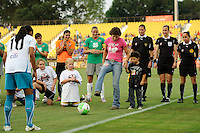 Michelle Akers performs the ceremonial first kick during the Women's Professional Soccer (WPS) All-Star Game at KSU Stadium in Kennesaw, GA, on June 30, 2010.