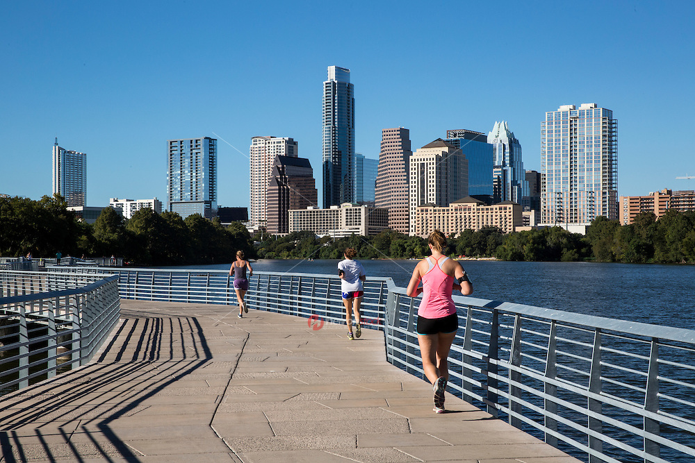 The Boardwalk Trail is the favorite running trail for Austin's runners and marathon and half marathon training programs with stunning views Austin cityscape skyline.