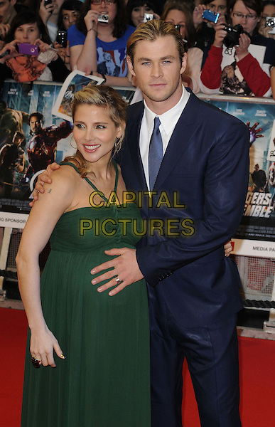 Elsa Pataky and Chris Hemsworth.'Marvel Avengers Assemble' European film premiere at Vue cinema, Westfield, London, England..19th April 2012.half length blue suit white shirt green dress pregnant couple hand on stomach belly.CAP/CAN.©Can Nguyen/Capital Pictures.