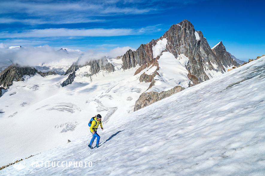Hiking up the south flank of the Oberaarhorn, 3631 meters, with the Finsteraarhorn in the background, Switzerland