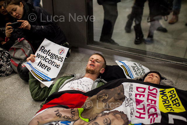 London, 16/01/2016. Today, activists from &quot;London2Calais&quot; and other organizations held a demonstration at London's Saint Pancras Eurostar Station to protest against the French Government decision to demolish a large section of the so-called 'Jungle' refugee camp in Calais. From the organisers Facebook page: &lt;&lt;&quot;We, the united people of the Jungle, Calais, respectfully decline the demands of the French government with regards to reducing the size of the Jungle. We have decided to remain where we are and will peacefully resist the government's plans to destroy our homes.&quot; -Statement from refugees on Monday 11/01/16. The French state is preparing to bulldoze large sections of the so-called 'Jungle' refugee camp in Calais. Around 2000 people have been given 3 days notice of the planned eviction, coerced into applying for asylum in France without providing a real alternative for them to live. Many of the people living in the Calais &quot;Jungle&quot;, including unaccompanied minors, have close family in the UK. As activists in Britain, we believe that while the &quot;Jungle&quot; is a symptom of the crisis in Calais and Dunkerque, the root cause is British migration and foreign policy. [&hellip;]&gt;&gt;.<br />