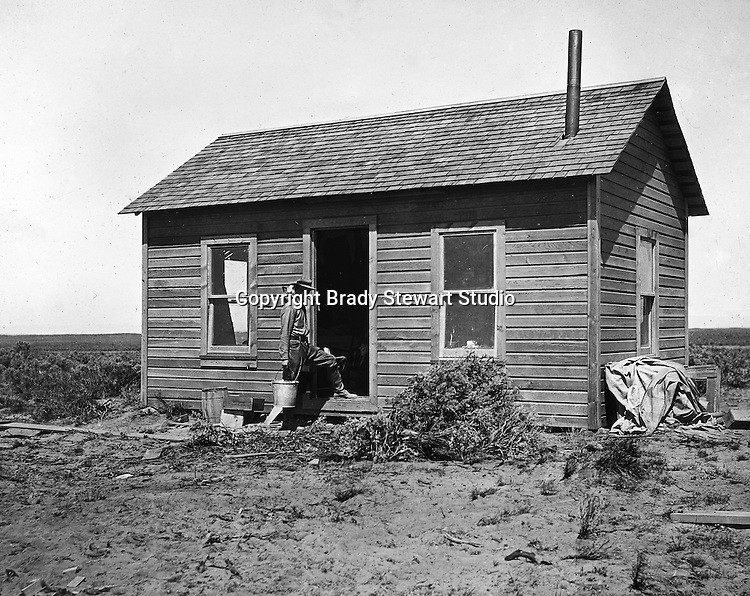 Jerome ID:  Brady Stewart repairing the farmhouse on the 160 acre estate - 1909.  Brady Stewart and three friends went to Idaho on a lark from 1909 thru early 1912. As part of the Mondell Homestead Act, they received a land grant of 160 acres north of the Snake River.  As part of the land grant, there was an old farmhouse that was in dire need of repair.  For 2 ½  years, Brady Stewart photographed the adventures of farming along with the spectacular landscapes.
