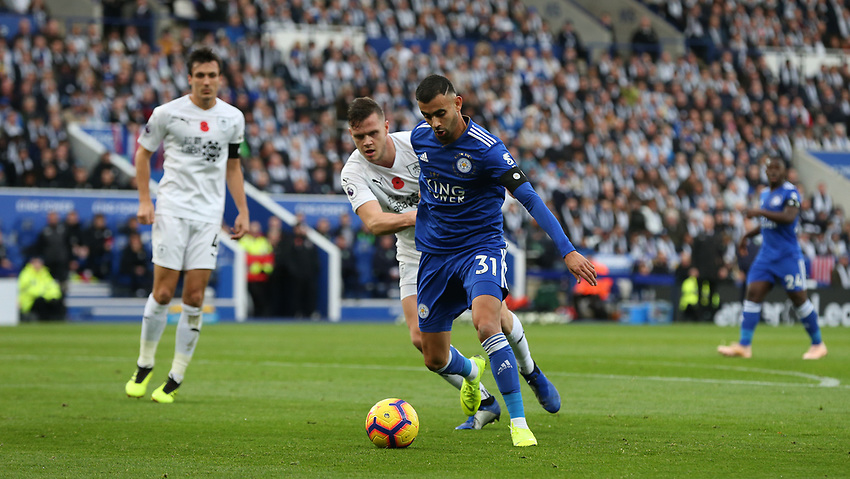 Leicester City's Rachid Ghezzal is tackled by Burnley's Kevin Long<br /> <br /> Photographer Stephen White/CameraSport<br /> <br /> The Premier League - Saturday 10th November 2018 - Leicester City v Burnley - King Power Stadium - Leicester<br /> <br /> World Copyright © 2018 CameraSport. All rights reserved. 43 Linden Ave. Countesthorpe. Leicester. England. LE8 5PG - Tel: +44 (0) 116 277 4147 - admin@camerasport.com - www.camerasport.com