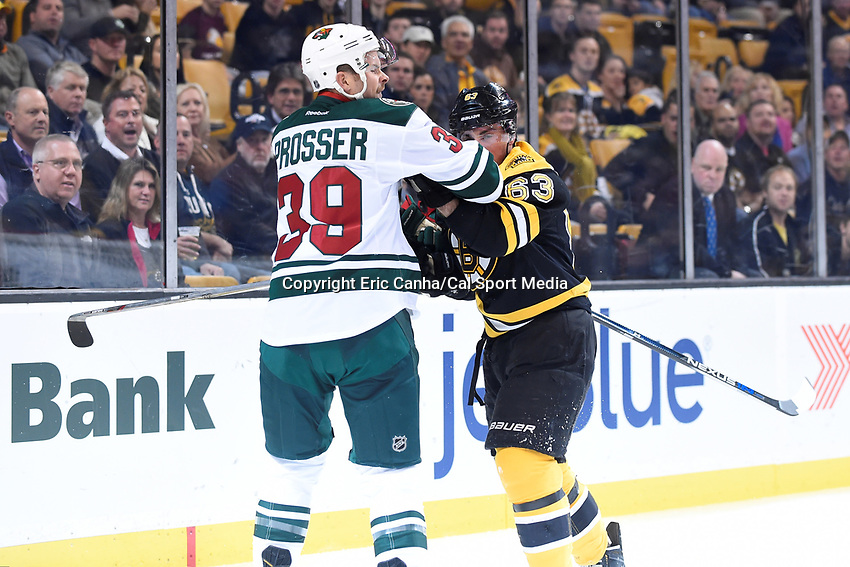 Thursday, November 19, 2015: Boston Bruins left wing Brad Marchand (63) makes contact with Minnesota Wild defenseman Nate Prosser (39) during the National Hockey League game between the Minnesota Wild and the Boston Bruins held at TD Garden, in Boston, Massachusetts. The Bruins defeat the Wild 4-2. Eric Canha/CSM
