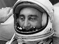"""Awaiting orders to proceed to the launch site for Project Mercury's second attempt to launch a man into space, astronaut Virgil I. """"Gus"""" Grissom relaxes in the Personal Equipment Room Hangar """"S,"""" Cape Canaveral, Fla. A parabolic Plexiglas mirror on his chest reflects the faces of two fellow Mercury pilots: Walter M. Schirra (left) and M. Scott Carpenter. (See the full resolution image.) The mirror, which was not included in the May 5 Shepard flight, will be used to reflect the instrument panel, bringing it into view of the pilot observer camera. MR-4 has rescheduled for Friday, July 21, 1961.<br /> <br /> The Liberty Bell 7 spacecraft, which carried Grissom 118 miles into space, carried a variety of instruments designed to record the pilot's every move during the flight for analysis by scientists after the flight. Unfortunately, the spacecraft sank shortly after Grissom exited the craft and was not recovered at that time. Almost 38 years to the day since it sank, the craft was recovered on July 20, 1999. According to CNN, the capsule was """"found at a depth of more than 15,000 feet -- 3,000 feet deeper than the wreck of the Titanic.""""<br /> <br /> Image Credit: NASA"""
