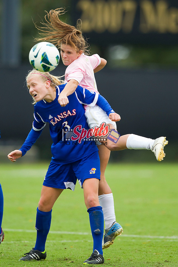 Ally Berry (8) of the Wake Forest Demon Deacons heads the ball away from Sarah Robbins (3) of the Kansas Jayhawks at Spry Soccer Stadium on October 7, 2012 in Winston-Salem, North Carolina.  The Demon Deacons and the Jayhawks battled to a 1-1 tie in double overtime.  (Brian Westerholt / Sports On Film)