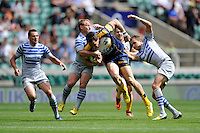 Jordan Smiler of the Brumbies is tackled during the World Club 7s at Twickenham on Sunday 18th August 2013 (Photo by Rob Munro)