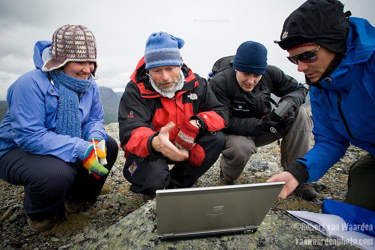 Bernd Etzelmuller, professor, displays the temperature curve of the Bore Hole on his computer.