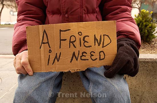 homeless man with &quot;a friend in need&quot; sign. The LDS Church is purchasing the Crossroads Mall in downtown Salt Lake City.; 03.19.2003, 12:57:37 PM<br />