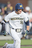 Michigan Wolverines first baseman Jake Bivens (18) runs to first base against the Michigan State Spartans during the NCAA baseball game on April 18, 2017 at Ray Fisher Stadium in Ann Arbor, Michigan. Michigan defeated Michigan State 12-4. (Andrew Woolley/Four Seam Images)