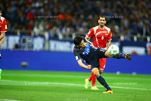 Shinji Kagawa (JPN), Mohamad Zaher Al Midani (SYR),<br /> MARCH 29, 2016 - Football / Soccer :<br /> Shinji Kagawa of Japan scores his team's second goal during the FIFA World Cup Russia 2018 Asian Qualifier Second Round Group E match between Japan 5-0 Syria at Saitama Stadium 2002 in Saitama, Japan. (Photo by Kenzaburo Matsuoka/AFLO)