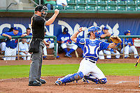 John Cannon (12) of the Ogden Raptors behind the plate with home plate umpire Ryan Powers during the game against the Missoula Osprey in Pioneer League action at Lindquist Field on August 5, 2014 in Ogden, Utah.  (Stephen Smith/Four Seam Images)