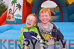 Tony White and Cian Lovette enjoying the bouncy castle at the Caherleaheen National School Gadren Fete on Sunday.
