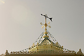 Victorian cast iron bandstand roof with weather vane. The Leas, Folkestone, Kent.