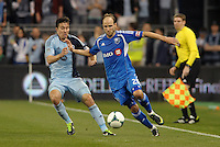 Justin Mapp (21) midfield Montreal Impact holds off Matt Besler (5) defender Sporting KC. Sporting Kansas City defeated Montreal Impact 2-0 at Sporting Park, Kansas City, Kansas.