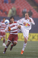 Red Bulls midfielder (13) Clint Mathis plays the ball in front of FC Dallas midfielder (8) Juan Toja. The NY Red Bulls defeated FC Dallas 3-0 at Giants Stadium, East Rutherford, NJ, on April 15, 2007.