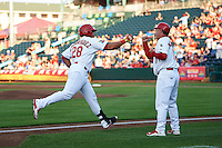 Springfield Cardinals first baseman Jonathan Rodriguez (28) fist bumps manager Dann Bilardello (11) after hitting a home run during a game against the Frisco RoughRiders  on June 4, 2015 at Hammons Field in Springfield, Missouri.  Frisco defeated Springfield 8-7.  (Mike Janes/Four Seam Images)