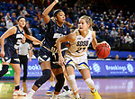 BROOKINGS, SD - NOVEMBER 21: South Dakota State Jackrabbits guard Tylee Irwin #21 drives against Montana State Bobcats guard Darian White #24 during their game Thursday night at Frost Arena in Brookings, SD.  (Photo by Dave Eggen/Inertia)