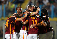 Calcio, Serie A: Frosinone vs Roma. Frosinone, stadio Comunale, 12 settembre 2015.<br /> Roma&rsquo;s Juan Iturbe is hidden by teammates' hugs after scoring during the Italian Serie A football match between Frosinone and Roma at Frosinone Comunale stadium, 12 September 2015. Roma won 2-0.<br /> UPDATE IMAGES PRESS/Riccardo De Luca