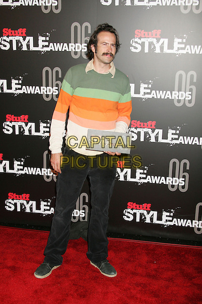 "JASON LEE.""The Stuff Style Awards"" hosted by Stuff Magazine held at The Arclight, Hollywood, California, USA..September 27th, 2006.Ref: ADM/RE.full length green orange striped stripes top black jeans denim.www.capitalpictures.com.sales@capitalpictures.com.©Russ Elliot/AdMedia/Capital Pictures."
