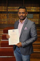 Abdullah Al Mamun with his certificate at the Citizenship Ceremony at Carmarthen Register Office, Carmarthenshire, Wales, UK. Monday 22 August 2016