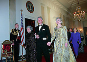 United States President Bill Clinton, center, escorts former first lady Lady Bird Johnson, left, and current first lady Hillary Rodham Clinton, right, to the 200th Anniversary of the White House Dinner in Washington, D.C. on November 9, 2000. Also visible at right are former U.S. President George H.W. Bush, former first lady Betty Ford, and former first lady Barbara Bush.<br /> Credit: Ron Sachs / CNP