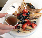 French Toast with blueberrries, strawberries and syrup at The Peacock Diner at 6261 Delmar In The Loop.
