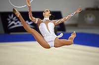 Sept 21, 2007; Patras, Greece;  Anna Bessonova of Ukraine split leaps to recatch hoop on way to winning the All Around gold at 2007 World Championships in rhythmic gymnastics at Patras.  Photo by Tom Theobald.