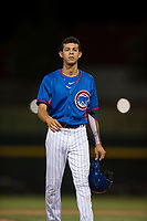 AZL Cubs 2 right fielder Ezequiel Pagan (32) walks off the field between innings of an Arizona League game against the AZL Rangers at Sloan Park on July 7, 2018 in Mesa, Arizona. AZL Rangers defeated AZL Cubs 2 11-2. (Zachary Lucy/Four Seam Images)
