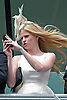 "LARA STONE BRAVES THE BLAST OF WIND TO CAPTURE THE ROYAL PROCESSION ON HER MOBILE.She was accompanied by husband DAVID WALLIAMS who presented a trophy for The King Edward Vll Stakes, Royal Ascot 2012 Day4, Ascot_22/06/2012.Mandatory Credit Photo: ©Dias/NEWSPIX INTERNATIONAL..**ALL FEES PAYABLE TO: ""NEWSPIX INTERNATIONAL""**..IMMEDIATE CONFIRMATION OF USAGE REQUIRED:.Newspix International, 31 Chinnery Hill, Bishop's Stortford, ENGLAND CM23 3PS.Tel:+441279 324672  ; Fax: +441279656877.Mobile:  07775681153.e-mail: info@newspixinternational.co.uk"