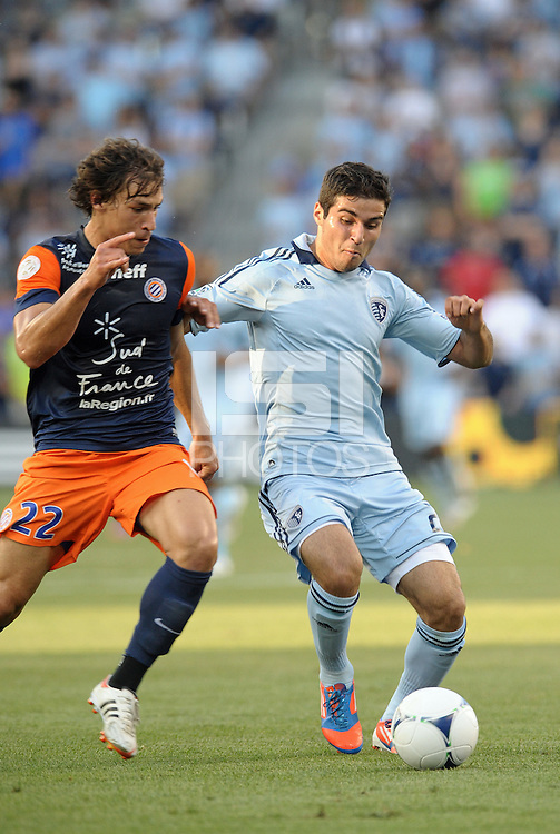 Soony Saad (22) forward Sporting KC watched by Benjamin Stambouli (22) midfield Montpellier..Sporting Kansas City were defeated 3-0 by Montpellier HSC in an international friendly at LIVESTRONG Sporting Park, Kansas City, KS..