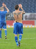FUSSBALL   1. BUNDESLIGA   SAISON 2012/2013   20. SPIELTAG    TSG 1899 Hoffenheim - SC Freiburg      02.02.2013 Eugen Polanski (TSG 1899 Hoffenheim) mit nacktem Oberkoerper im Regen