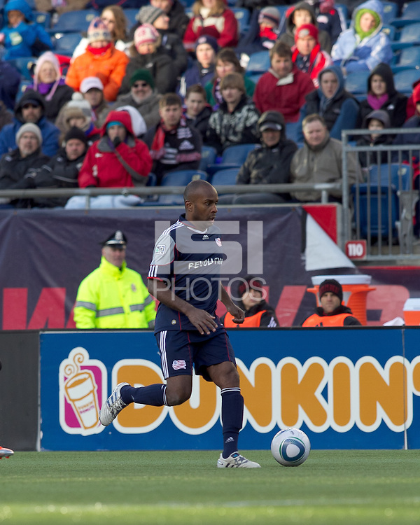 New England Revolution defender Didier Domi (3) brings the ball forward. In a Major League Soccer (MLS) match, the New England Revolution defeated DC United, 2-1, at Gillette Stadium on March 26, 2011.