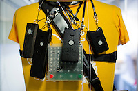 Various versions of the sociometric badge designed in the Human Dynamics Laboratory hang on a dummy in the Media Lab at MIT in Cambridge, Massachusetts, USA. The badges measure face-to-face interaction involving the person wearing it.