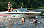 Southbury, CT- 17 July 2015-071715CM01- Brenton Hard, a staff member with VISIONS, left, swims out to help Dale Lane who was learning to waterski on Lake Zoar in Southbury on Friday.  Lane who is visually impaired was leaning to waterski with the help of Leap of Faith Adaptive Skiers, an organization based out of Newton, CT.   Looking on from the boat are volunteers, Madeline Leonard and Chad Goodhue.   Christopher Massa Republican-American