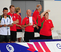 The Welsh official support Jack Thomas as he takes the bronze medal in the men's para-sport 200m freestyle S14 final<br /> <br /> Photographer Chris Vaughan/CameraSport<br /> <br /> 20th Commonwealth Games - Day 3 - Saturday 26th July 2014 - Swimming - Tollcross International Swimming Centre - Glasgow - UK<br /> <br /> © CameraSport - 43 Linden Ave. Countesthorpe. Leicester. England. LE8 5PG - Tel: +44 (0) 116 277 4147 - admin@camerasport.com - www.camerasport.com