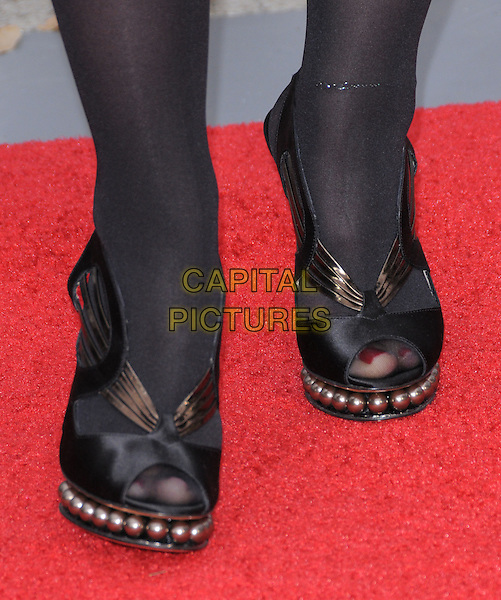 """LEAH REMINI's shoes .at the CBS Films' L.A. Premiere of """"The Back-Up Plan"""" held at The Village Theatre in Westwood, California, USA, April 21st, 2010..arrivals detail pearls beaded beads  black peep toe platform shoes .CAP/RKE/DVS.©DVS/RockinExposures/Capital Pictures."""
